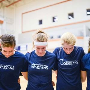 TWU Spartans huddle up for prayer before practice. Courtesy Katrina Grabowski/TWU