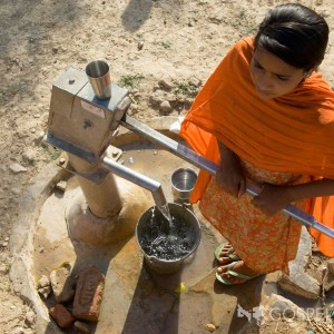 An Indian girl pumps clean water from a Gospel For Asia Jesus Well. Photo courtesy of Gospel For Asia.