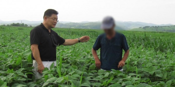 Detained pastor Hyeon Soo Lim talks with a worker at one of the Light Presbyterian Church's agricultural projects in North Korea. Photo courtesy of Light Presbyterian Church.